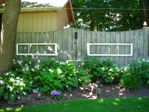 windows decorate fence Lockport garden walk