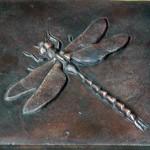 dragonfly tile in Buffalo garden