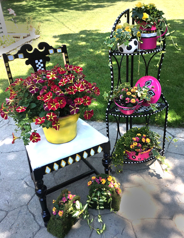 painted furniture and flowers in pot in Lewiston, New York