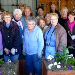 Orchard Park NY Garden Club planting with village