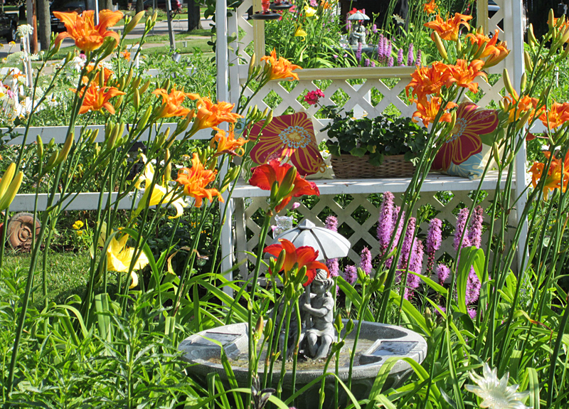 Here's a view of the Hagemans' yard in September. An English bench provides seating while tiger lilies, blazing stars and day lilies surround the fountain. Photo courtesy Debbie Hageman