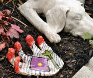 ceramic hand in Lancaster NY garden