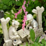 statue with bleeding heart flower in Lancaster NY garden