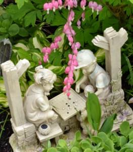 statue with bleeding heart flower in Lancaster NY garden