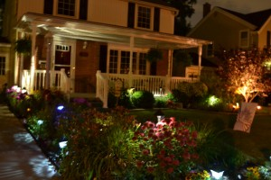 front of house after dark on Ken-Ton NY garden walk