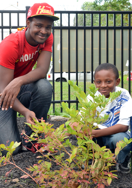 teen and boy in Buffalo teaching garden
