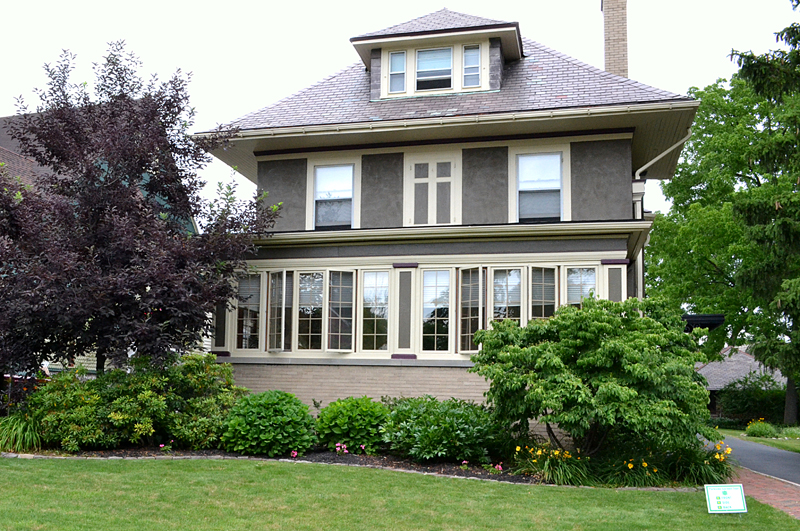 100 year old house features large perennial border in long for Features of old houses