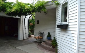 arbor by garage leading to backyard room in Buffalo NY