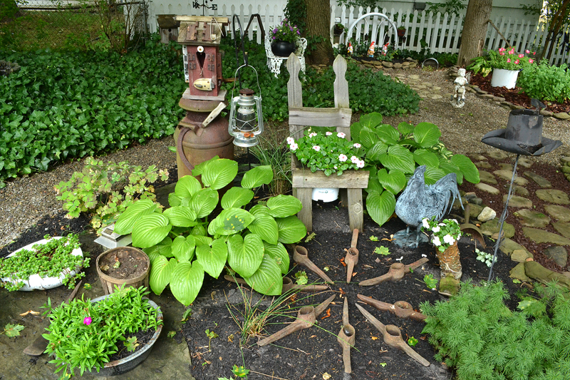 pick axes and bed pan as garden decorations