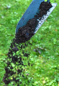garden soil dropping from trowel