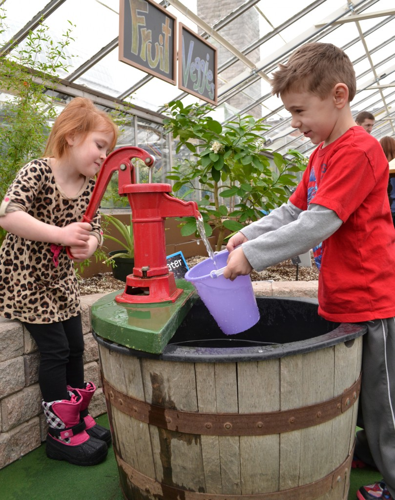 Sarah Amborski, 5, left, and Kaden Danstetter, 5, work as a team to fill, dump and refill the bucket with water.