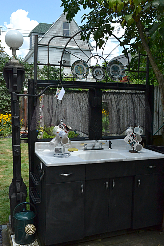 working sink in yard of artist in Buffalo NY