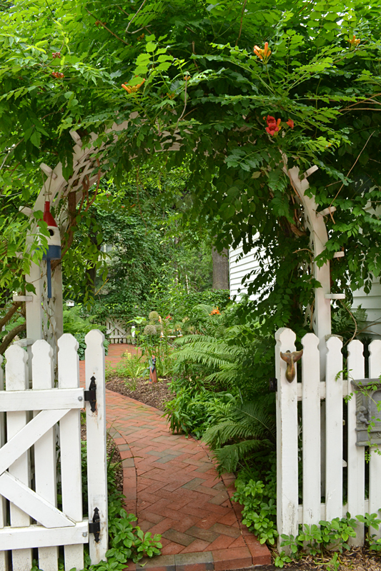 arched arbor in garden in Lockport NY