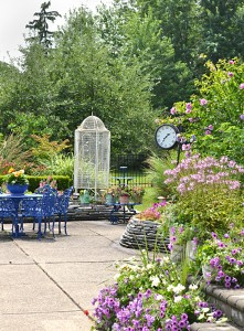 aviary and street clock in garden in Amherst NY