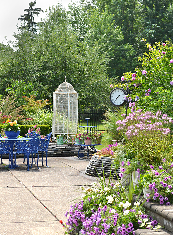 aviary and street clock in garden in Amherst NY