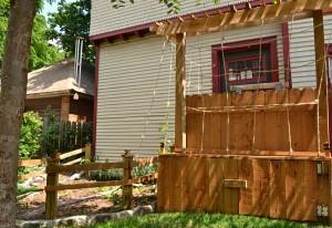 raised garden with door to harvest yams