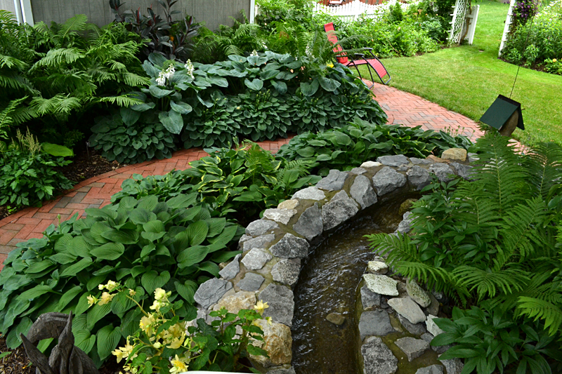 Brick paths stone waterfall are highlights of lockport for Landscaping rocks buffalo ny