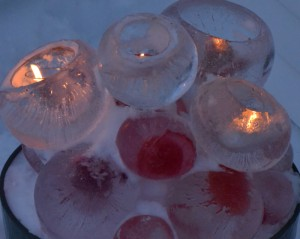 ce spheres and candles in snow in Amherst NY