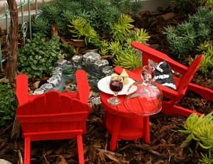 Adirondack chairs in miniature garden