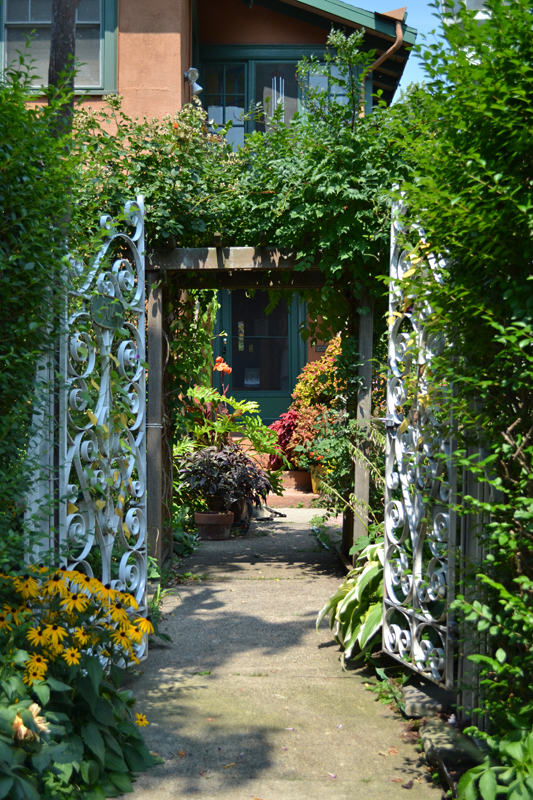 gate looking into garden and house in Buffalo NY