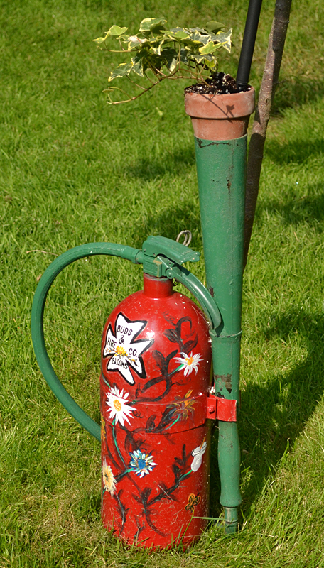 fire extinguisher as garden art in Lancaster NY