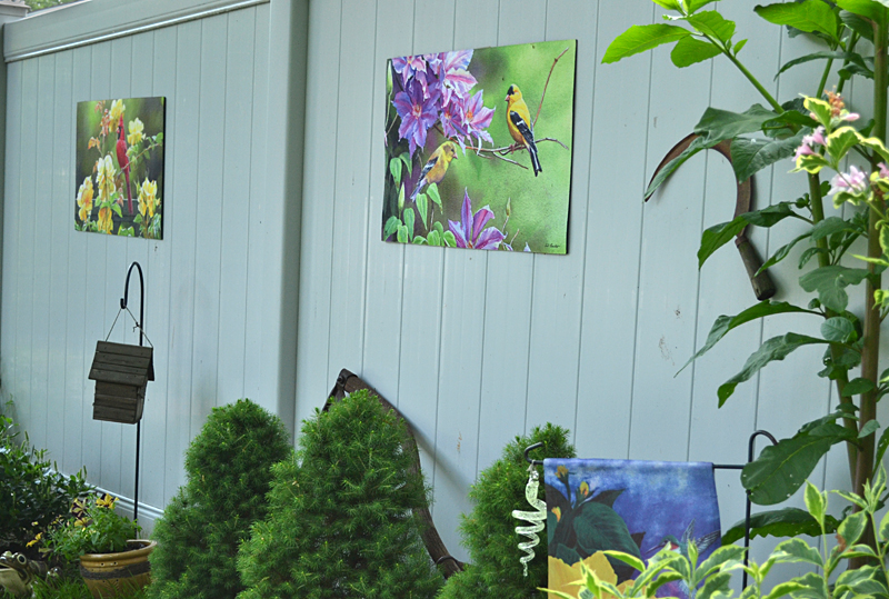 rugs displayed on fence as garden art in Lancaster NY