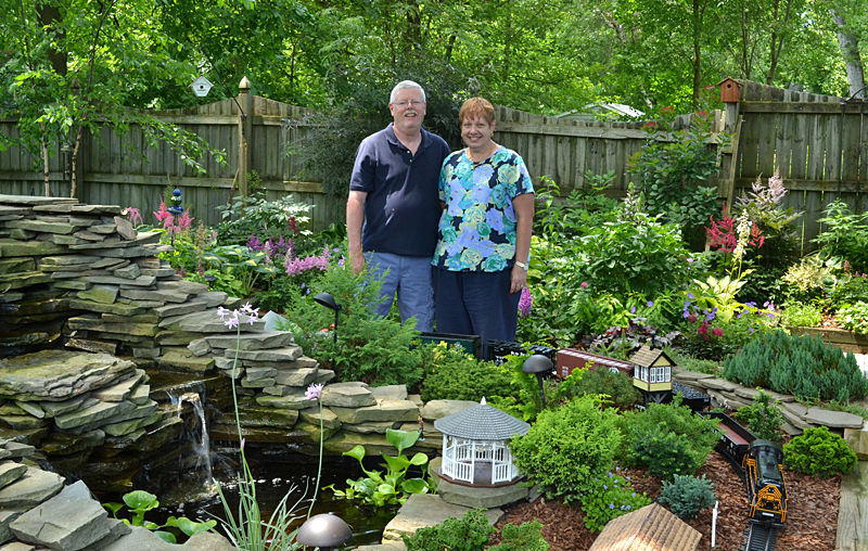 Barb and Dave Whittemore in garden in Hamburg NY