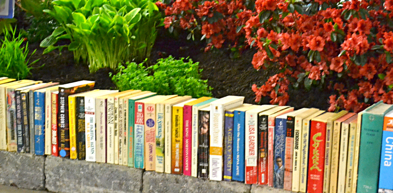 garden retaining wall made of books in Hamburg NY