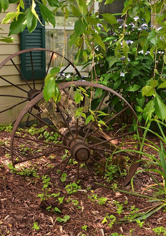 metal wagon wheels as garden art Lockport