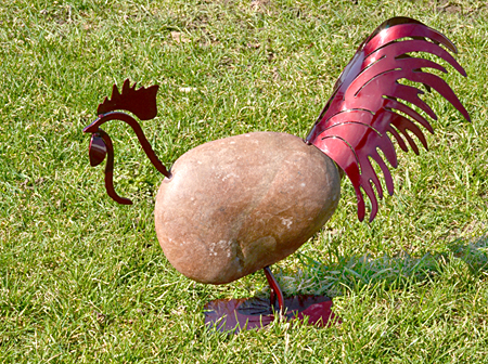 rooster made of fieldstone