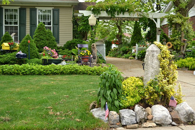 hitching post and shrubs in Lancaster NY