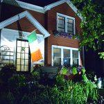 gardens and Irish flag at front of house in Tonawanda