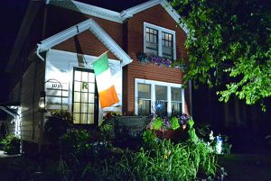 gardens and Irish flag at front of house in Tonawanda