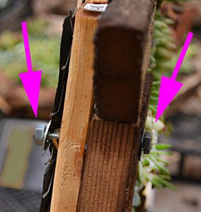 bolts on frame of vertical succulent container
