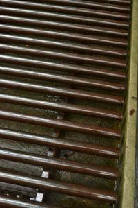closeup of metal tubes in deer grate