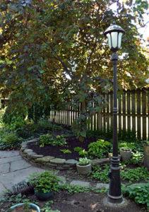 circular garden bed and street light in Buffalo backyard