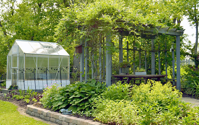 greenhouse and vegetable garden and arbor in Springville, New York