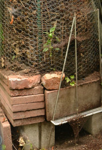 composter made of bricks and chicken wire