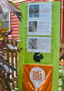 green door with posters on Black Squirrel Garden Walk in Niagara Falls