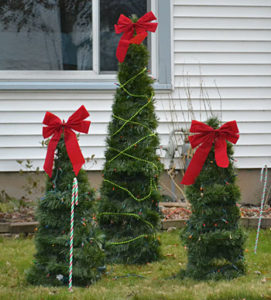 three Christmas trees made from tomato cages