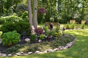 large garden around tree in Grand Island NY