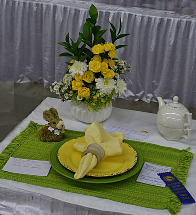 flower arrangement and table setting