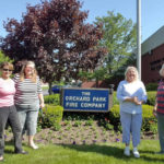 Orchard Park Garden Club plant flowers at fire hall