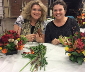 making Thanksgiving arrangement at the Buffalo and Erie County Botanical Gardens