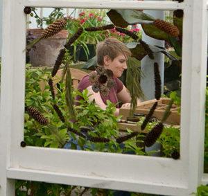 woman seen through mandala at Buffalo & Erie County Botanical Gardens