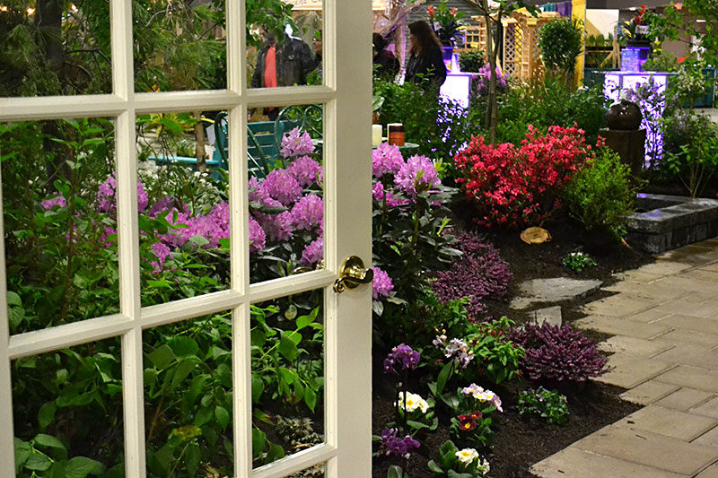 looking through door to garden at Plantasia 2019 created by Dore