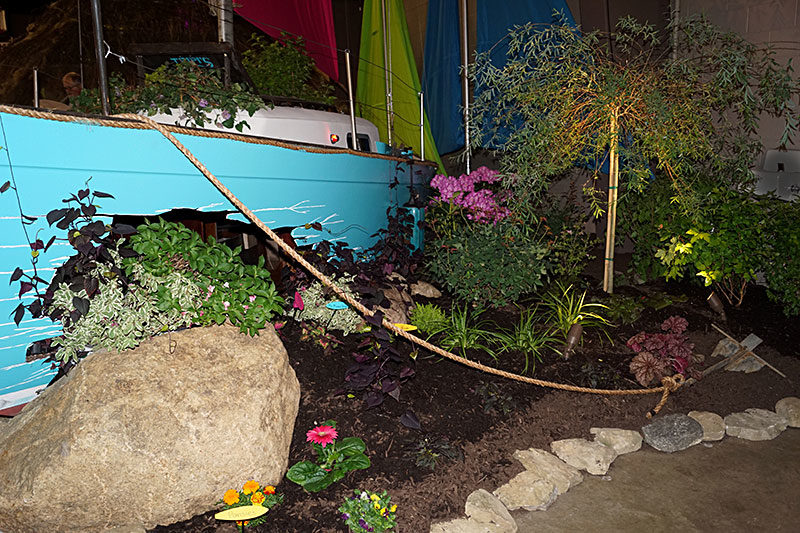 sailboat in garden by Tripi's Landscaping at Plantasia 2019