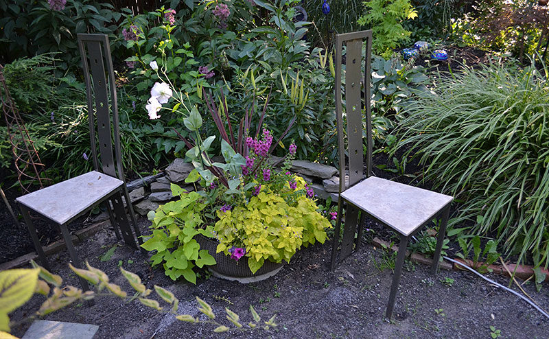 metal garden chairs facing in different directions