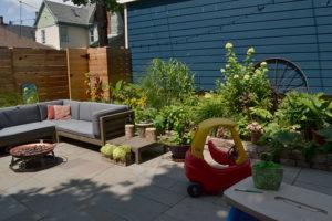 neighbor's garage and new patio