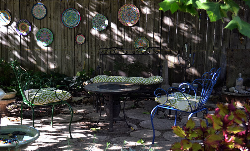 seats on patio with mandalas